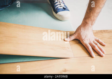 Connection of two laminate panels across a short joint in the lock - Stock Photo