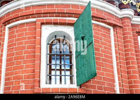 Russian ancient architecture. Old brick wall with an old window of Saint Basil's (Pokrovsky) Cathedral in Moscow, Russia - Stock Photo