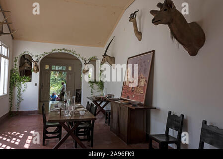 The dining room with some of American author, Ernest Hemingway's hunting trophies from Africa on the wall at his home, Finca La Vigia, in San Francisc - Stock Photo