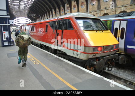 Class 91 LNER 91130 ' Lord Mayer of Newcastle ' electric locomotive at York Railway Station, North Yorkshire, England, UK. - Stock Photo