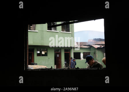 La Paz, Bolivia. 12th Nov, 2019. People are standing next to a destroyed police station. After the resignation of Bolivian President Morales, marauding gangs in the South American country are up to no good - now the military want to put an end to the spook. Credit: Gaston Brito/dpa/Alamy Live News - Stock Photo