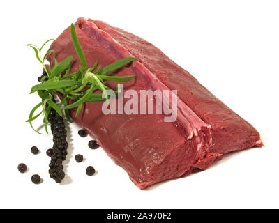 Roe Deer - Wild Game Meat on wooden Background - Stock Photo
