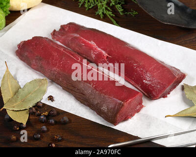 Roe Deer Fillet - Wild Game Meat on wooden Background - Stock Photo