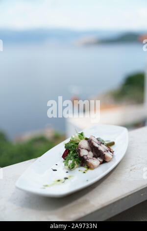Plate of octopus, Konoba Nada, on Krk island, Croatia - Stock Photo