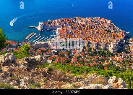 Aerial view of The Old Town of Dubrovnik with City wall, towers, forts and Old Harbour in Dubrovnik, Croatia - Stock Photo