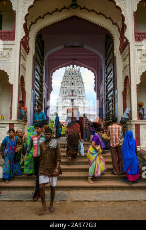 Pushkar, Rajasthan, India: people enter and leave the Rangji Temple dedicated to Lord Vishnu - Stock Photo