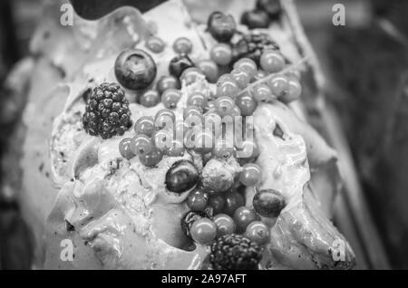 delicious italian ice-cream wit fresh fruits & mix of nuts, seeds, pistachio, chocolate flakes - Stock Photo