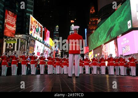 The U.S. Marine Drum and Bugle Corps conduct a musical ballad at Times Square in honor of the Marine Corps' 244th Birthday November 10, 2019 in New York City, New York. - Stock Photo