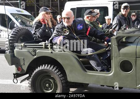 Former Apollo 11 Astronaut Buzz Aldrin drives a Willys Jeep during the New York City Veterans Day Parade on November 11, 2019 in New York City, New York. - Stock Photo