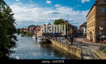 Bamberg 2019. View of the district called Little Venice. We are on a warm and cloudy summer afternoon and tourists enjoy the view of the Regnitz river - Stock Photo