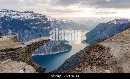 Beautiful hike in the middle of the wilderness in Norway.One of the most famous hikes in the world with a rewarding view from the tongue of the troll, Stock Photo