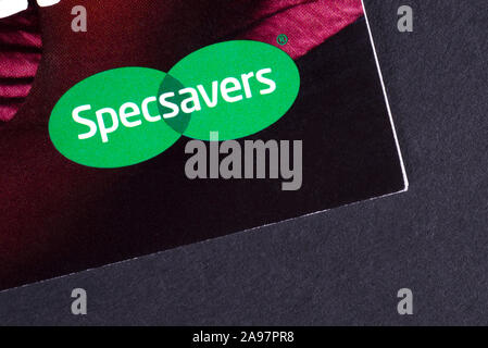 London, UK - March 7th 2019: The company logo of Specsavers, pictured on a leaflet.  Specsavers Optical Group Ltd is a British optical retail chain. - Stock Photo
