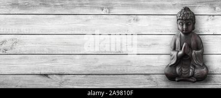 Buddha and wooden background - Stock Photo