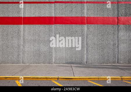 Sidewalk with concrete wall, urban background.