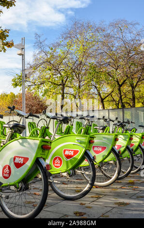 Budapest, Hungary - Nov 6, 2019: Public green bikes for rental in the center of the Hungarian city. Bike-sharing. Ecological mean of transport. Measure in the cities against air pollution. Bicycle. - Stock Photo