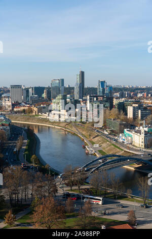 Photograph looking over the River Neris and towards the business district of Snipiskes in Vilnius, Lithuania on a fall or autumn afternoon.