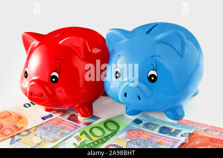 Euro and piggy banks against white background Stock Photo