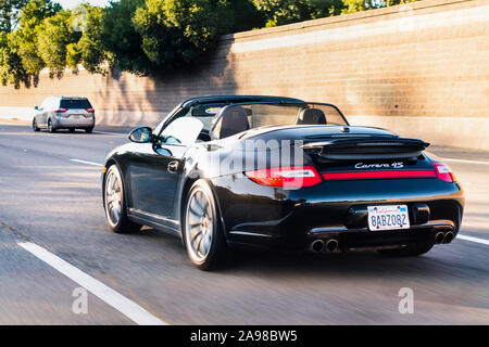 Oct 21, 2019 San Jose / CA / USA - Porsche Carrera 4S vehicle driving on a freeway in San Francisco Bay Area - Stock Photo