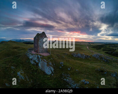 Aerial view of Smailholm Tower with the Eildon Hills in the distance - Stock Photo