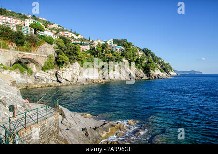 Breathtaking view on Mediterranean sea beach on Liguria region in Italy. Awesome landscape of Zoagli with colorful houses in sunny autumn day - Stock Photo