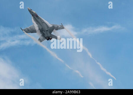 DAYTON, OHIO / USA - June 20, 2015: A United States Navy F/A-18 Super Hornet performs a demo at the 2015 Vectren Dayton Airshow. - Stock Photo