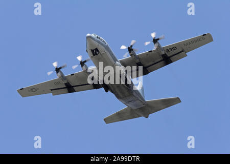 A United States Marine Corp C-130 Hercules that supports the U.S. Navy Blue Angels flies into the 2012 Dayton Airshow. - Stock Photo