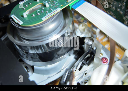 Cassette tape in Vhs video mechanism helical head - Stock Photo