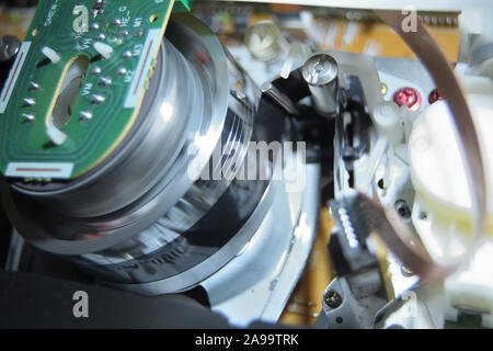 Vhs video mechanism helical head reading a videotape - Stock Photo
