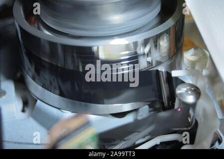 Cassette tape in Vhs video mechanism helical head reading a videotape - Stock Photo