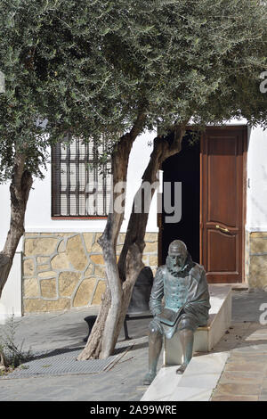 Sculpture of writer Cervantes in a andalusian street - Stock Photo