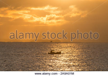 Newlyn, Cornwall, UK. 14th November 2019. UK Weather. A brief respite in the heavy rain and hail showers for Cornwall this morning. Credit Simon Maycock / Alamy Live News. - Stock Photo