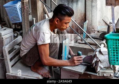 Local Men Working On and Preparing Jade At The Jade Market, Mandalay, Myanmar. - Stock Photo