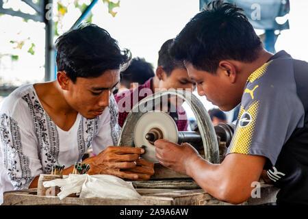 Local Men Working On and Preparing Jade At The Jade Market, Mandalay, Myanmar - Stock Photo