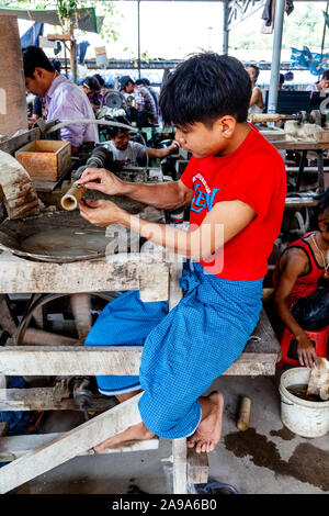 A Young Man Preparing and Working On Jade In The Jade Market, Mandalay, Myanmar - Stock Photo
