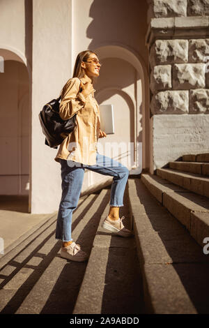 Pretty woman walking home after her working day - Stock Photo