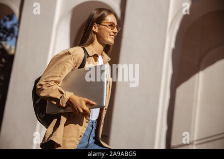 Woman being glad to take a stroll - Stock Photo