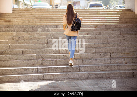 Beautiful woman going home after her stroll - Stock Photo