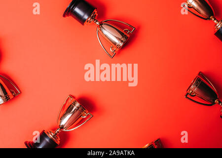 Winner or champion cup on bright background, Flat lay style. Open composition.
