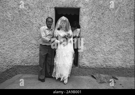 Bride leaves her parent's home, Hoti, northern Albania. 1992. - Stock Photo