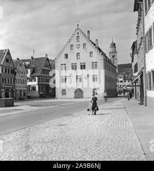 City hall near main market with minster St. John Baptist at the city of Bad Mergentheim, Germany 1930s. - Stock Photo