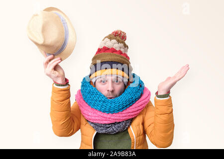 Funny caucasian man in several winter hats ans scarfs welcoming you. I glad to see you. - Stock Photo