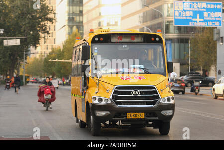 Beijing, China. 14th Nov, 2019. Yellow school buses operated by international schools drop off students in Beijing on Thursday, November 14, 2019. International schools, as well as some private Chinese schools, have adopted the iconic yellow school bus for student transportation. Photo by Stephen Shaver/UPI Credit: UPI/Alamy Live News - Stock Photo