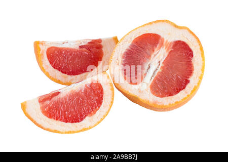 Close-up of a half and two quarter slices of a ripe pink grapefruit (Citrus paradisi), isolated on white background. - Stock Photo