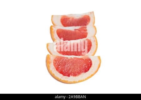 Close-up of four slices of a ripe pink grapefruit (Citrus paradisi) in line, isolated on white background. - Stock Photo
