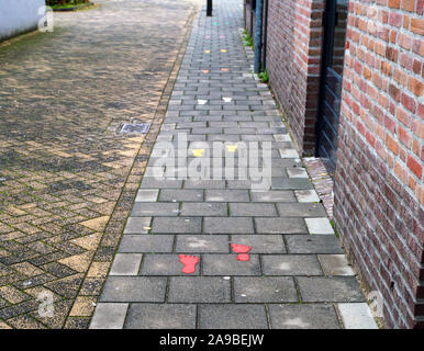 Sidewalk with painted colorful footsteps for children outside - Stock Photo