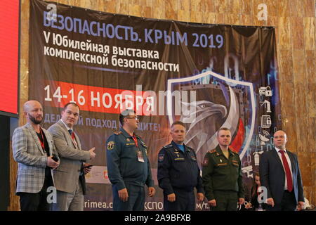 Yalta, Russia. 14th Nov, 2019. YALTA, CRIMEA, RUSSIA - NOVEMBER 14, 2019: People attend the 5th 'Safety. Crimea 2019' integrated security exhibition at the Yalta Intourist Hotel. Individual protective gear, special clothing, firefighting equipment, threat warning systems, video surveillance systems, etc are on display at the exhibition. Sergei Malgavko/TASS Credit: ITAR-TASS News Agency/Alamy Live News - Stock Photo