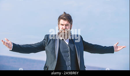 Hipster bearded attractive enjoy freedom. Guy enjoy top achievement. Man bearded proud himself sky background. Superiority and power. Feeling undefeated. Proud of himself. Self proud and narcissistic. - Stock Photo