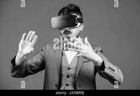 Digital future and innovation. bearded man wear wireless VR glasses. use future technology. businessman in VR headset. Visual reality. virtual reality goggles. Modern business. Amazing technology. - Stock Photo