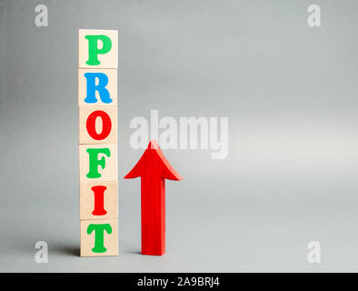 Wooden blocks with the word Profit and up arrow. Concept of business success, financial growth and wealth. Increase profits and investment fund. Perfo - Stock Photo