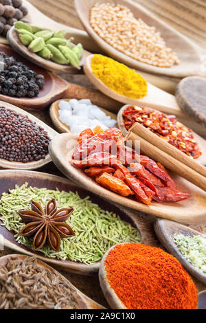 Selection of Spices and Wooden Spoons - Stock Photo